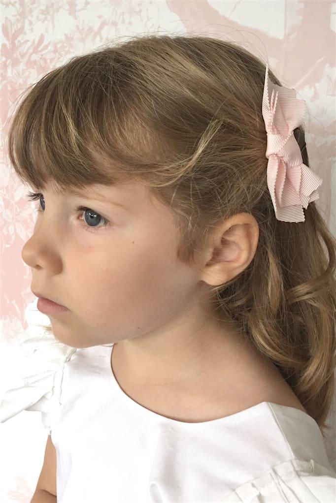 Barrette petite fille noeud rose