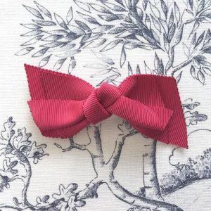 barrette noeud rouge carmin